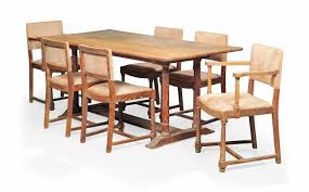 A HEALS LIMED OAK DINING TABLE AND CHAIRS