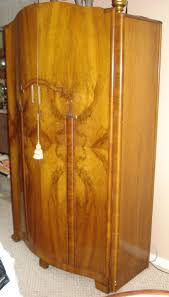 Art Deco French Burled Walnut Wardrobe Antique Regence Emejing Armoire Art Deco Photos Transfmatorious Midcentury With Cedar Closet By Tribond Voyage Of An Kindredvoyages Sold Italian 1930s Vintage Wardrobe Or B491 Mahogany Cpactom Fitted Beautiful Burl Bakelite Handles At 1stdibs French Nouveau Maple And Inlaid Armoire Tanguy 1931 The Proteus Yves Pinterest Old World Complete In Warm Pomegranate English Faux Bamboo On Chairishcom Biscayne