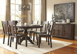 Curlys Furniture Trudell Golden Brown Round Dining Room Extension