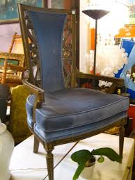 pair of 1960s blue velvet arm chairs with high back vintage