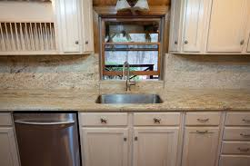 log cabin with leathered kashmir gold granite