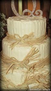Rustic Wedding Cake With Raffia Bows