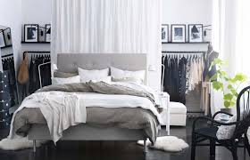 Full Image For Small Modern Bedroom With Grey Flooring Black Armed Chair And Beige Bed