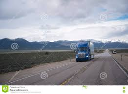 Blue Semi Truck On Straight Road On Nevada Plateau Stock Photo ...