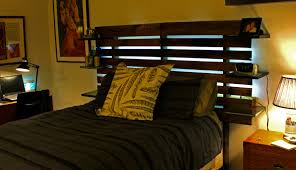 Black Wood Pallet Bed With High Headboard And Six Small Floa