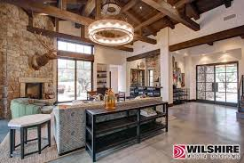 wilshire homes for a farmhouse living room with a home automation