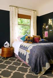 Give Your Black Bedroom A Bohemian Feel By Decorating With Patterned Pillows And Blankets Brighten Up The Room Whimsical String Of Lights