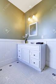 aqua and white bathroom with linoleum floor and white bathroom