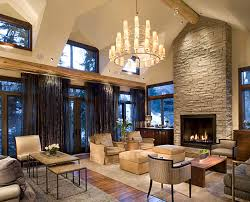 Stacked Stones Fireplace Ideas Displaying With Chandelier Bronze Over Midcentury Sofas As Well Dark Window Curtains Decorate Open Rustic Living Room