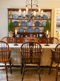 100 Dining Chairs Country English Style A Wrought Iron Chandelier With Candlelike Lights Accents This