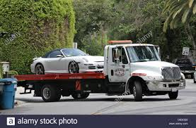 A Tow Truck Tows Victoria Beckham's Signature Porsche From Her Home ... Los Angeles Towing Services Has A New Medium Duty Wheel Lift Truck Airtalk In An Accident Beware Of Tow Truck Scammers 893 Kpcc San Pedro Ca 3108561980 Fast Lafd Tow Fire Youtube Industries Home Facebook Cole Keattss Car During The Red Bull Global R All N One 61770 Commercial St Joshua Tree 92252 Ypcom Best Image Kusaboshicom Trucks In Impounded Cars Towing Fees Waived For Theft Victims Living Sf Flatbed Rental Resource Food La Stainless Kings