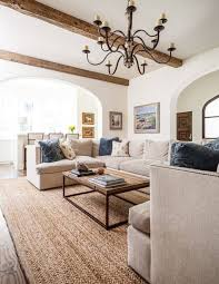 Heres A More Contemporary Living Room Design With White Walls Hardwood Flooring And