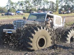 100 Jacked Up Mud Trucks Big Wheels Roll At Boggin Bunnell Mud Fest