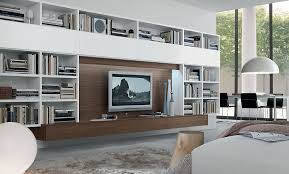 View In Gallery Exclusive Wall Unit With Ample Space For Book Storage And Entertainment Hub