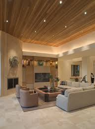 Large Living Room In Beige Color Scheme With Elevated Wood Ceiling