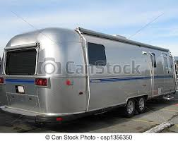 Old Silver And Blue Caravan Stock Photo