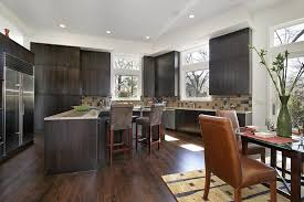 Solid Dark Minimalist Panelling Here Accentuates The Natural Hardwood Flooring With White Walls And
