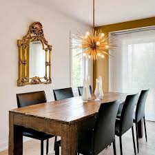 reclaimed wood dining table with black leather dining chairs