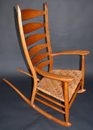 This Appalachian Ladder Back Rocking Chair Is Made Of Black Acacia ... Unfinished Voyageur Twoperson Adirondack Rocking Chair Doc And Merle Watson Red Chords Chordify Wicker Made Rattan Old Wood Stock Appalachian Que Sera Whatever Will Be Windsor Plans Woodarchivist This Ladder Back Is Made Of Black Acacia The Brumby Company Antique Quilting Porch Etsy Inside Log Cabin With By Window Photo Image
