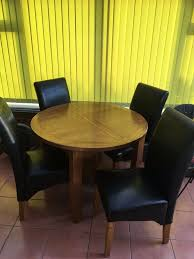 Extendable Solid Oak Dining Table And 4 Black Leather Chairs | In Norwich,  Norfolk | Gumtree
