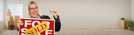 Download Banner Of Adult Woman Inside Room With Boxes Holding House Keys Stock Photo