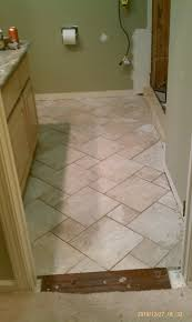 how do you handle transition from hardwood to cut tile with no