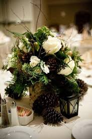 Natural And Simple Pinecone Wedding Centerpiece Winter CenterpiecesPinecone CenterpieceWinter DecorationsWinter