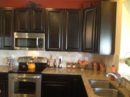 Kitchen Backsplash Ideas With Dark Oak Cabinets by Cream Medium Square Tile Back Splash Combined With Black Wooden
