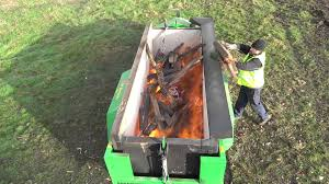 Air Curtain Destructor Burning by Burnboss Mobile Incinerator Youtube