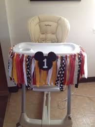 mickey mouse high chair decoration and 1 poster of pictures