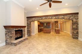 Three Stone Wall Accents Tie Together The Open Concept Kitchen And Great Room Which Features A Gas Fireplace Wet Bar With Raised Seating