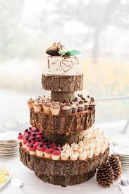 Rustic Wood Slice Cupcake Stand And A Bark Styled Wedding Cake