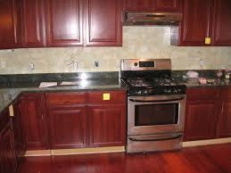 legacy cherry cabinets with granite and ceramic tile backsplash