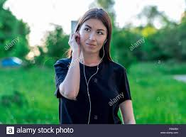 In Summer Park Listen To Music Dressed Casual Clothes The Brunette Dreams Of Good Smiles Thinks Positive Thoughts Voice Headphones On