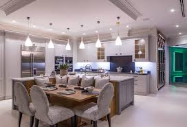 An Open Plan Kitchen Merging With The Dining Room