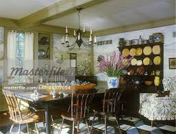 DINING ROOMS Primitive Furniture Painted Mural Of Hunt Scene Yellow Stoneware Displayed On Black Side Cabinet Wood Dough Bowl Filled With Antique Candy