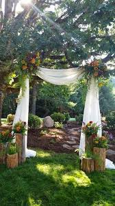Wood Uprights Of Different Heights To Decorate Tent Poles Base Trees Door Frames Etc Back Yard Ceremony Setting By Savvy Sisters Inc