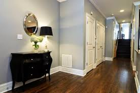 hallway with light grey wall colors and wooden floors the right