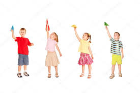 Group Of Children Playing With Paper Airplanes Stock Photo