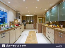 large modern kitchen in villa with recessed ceiling lights