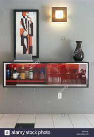 Picture Above Wall Mounted Drinks Cabinet In Modern Gray Dining Room