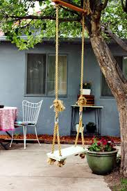 Traditional Patio Decor Completed With Metal Outdoor Chair And Round Coffee Table Combined Impressive Swing For Tree Beside Potted Flowers