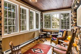 Rustic Sunroom With Small Bookcase Wood Armchairs Southwestern Carpet Runner