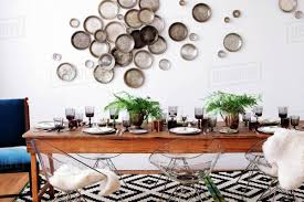 100 Decorated Wall Arranged Dining Table Against Decorated Wall Stock Photo Dissolve