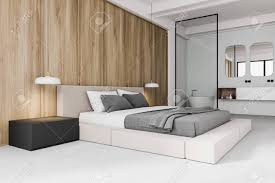 stylish master bedroom interior with white and wooden walls