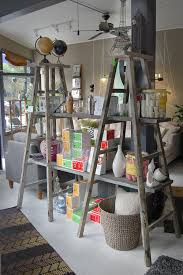 rustic style of ladder booksehlving with drawer storage home track