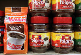 Packages Of Folgers And Dunkin Donuts Coffee Are Displayed On A Shelf At Cal Mart