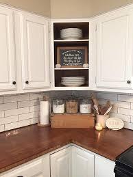 Farmhouse kitchen butcher block subway tile open cabinets