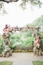 Gorgeous Floral Wedding Ceremony Arch With Tree Stumps By Hey Events
