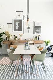 weißer esstisch mit schalenstühlen und bild kaufen